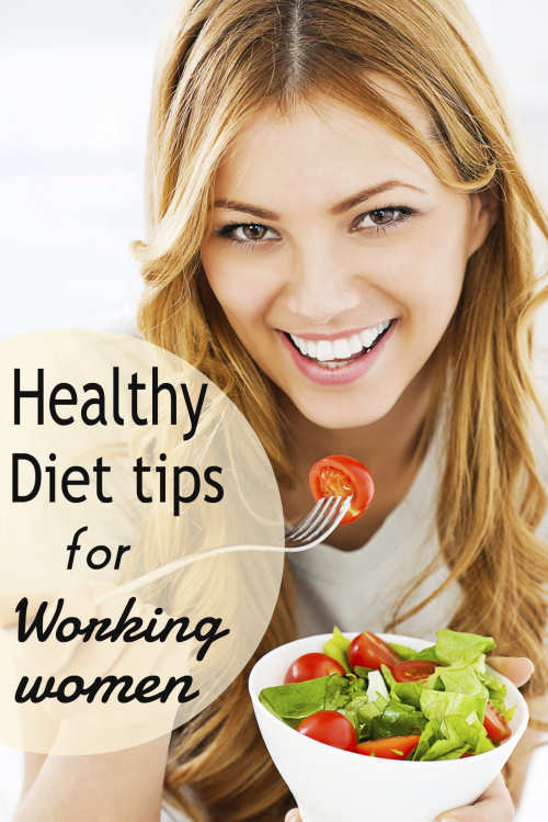 Cheerful blonde woman holding a bowl of vegetable salad and she is eating it.