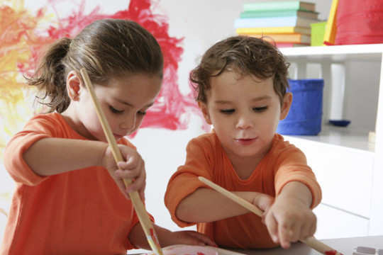 2-children-playing-painting