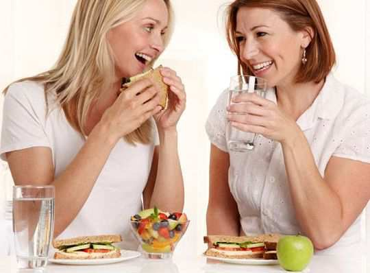 women-drink-water-after-food