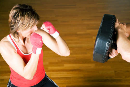 woman-doing-cardio-punches