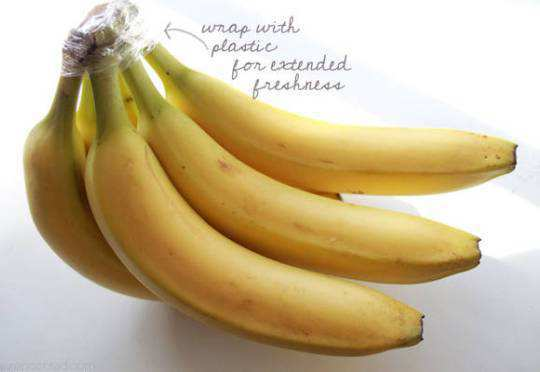 Cover-the-Top-of-a-Bunch-of-Bananas-with-a-Plastic-Wrap