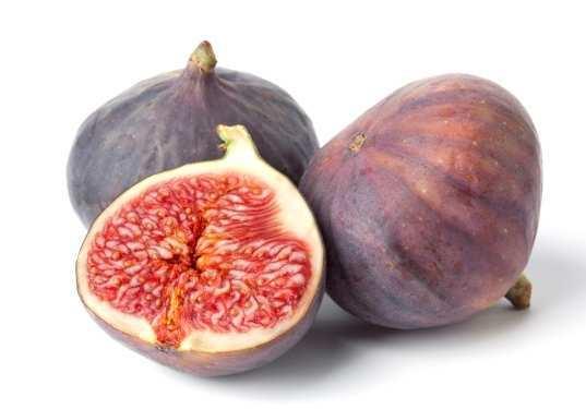 Fresh figs on plain background