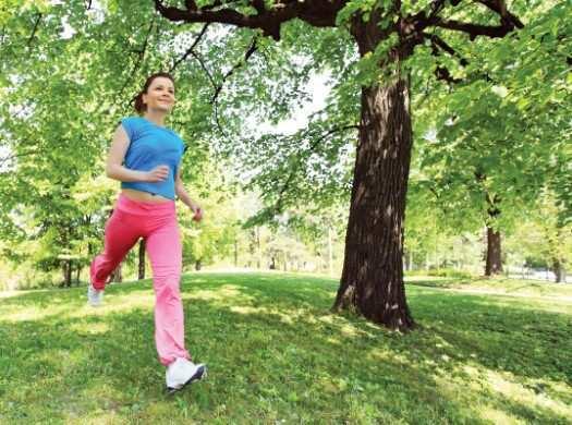 Girl running in the park.