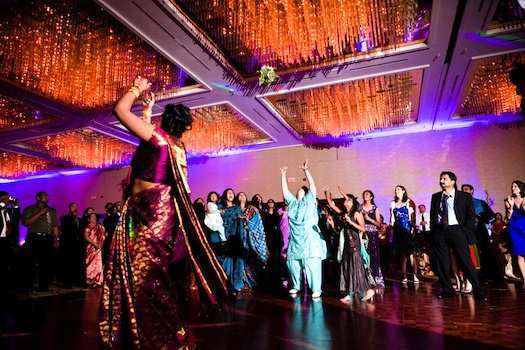 tossing-the-bouquet-at-an-Indian-wedding