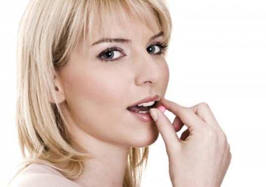 woman-eating-pill