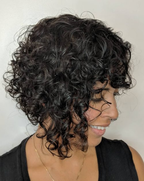 curly short stacked bob with bangs for women