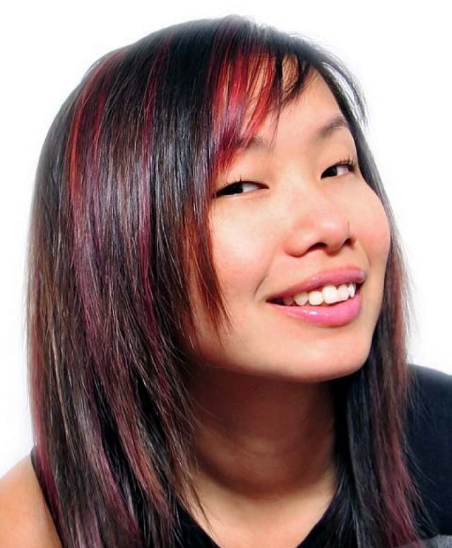 Asian layered hair with red highlights