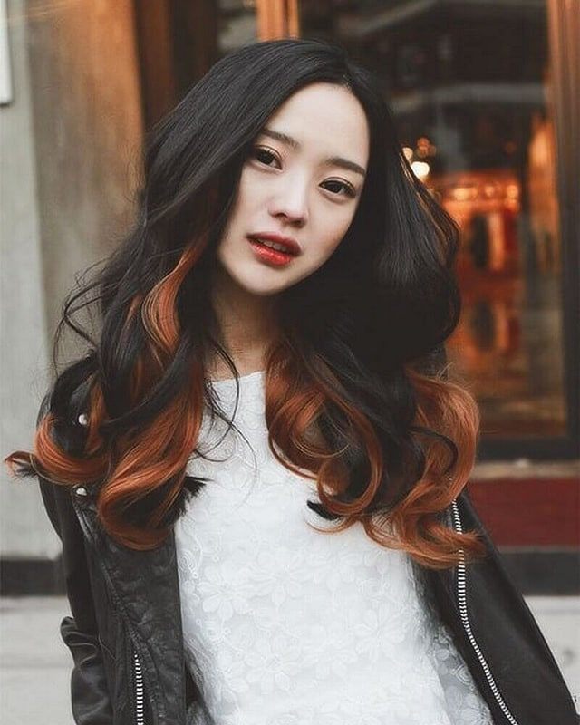 Asian girl with red highlights hairstyle