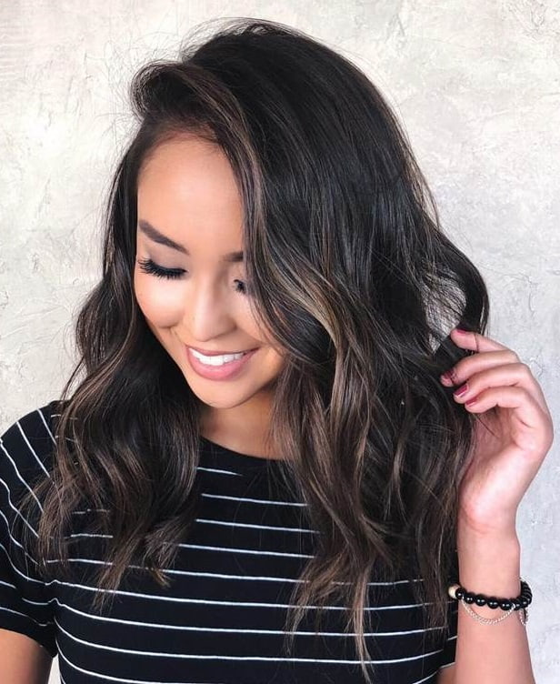 black wavy hair with copper brown highlights