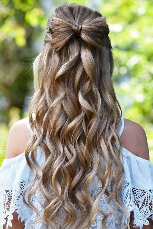 curly half up hair with bow bun