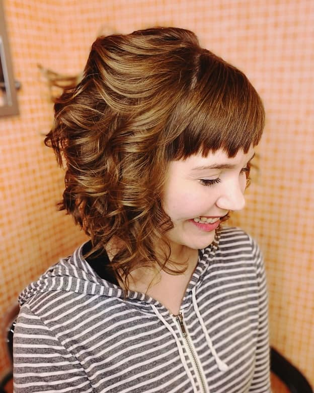 curly inverted bob with layers and baby bangs