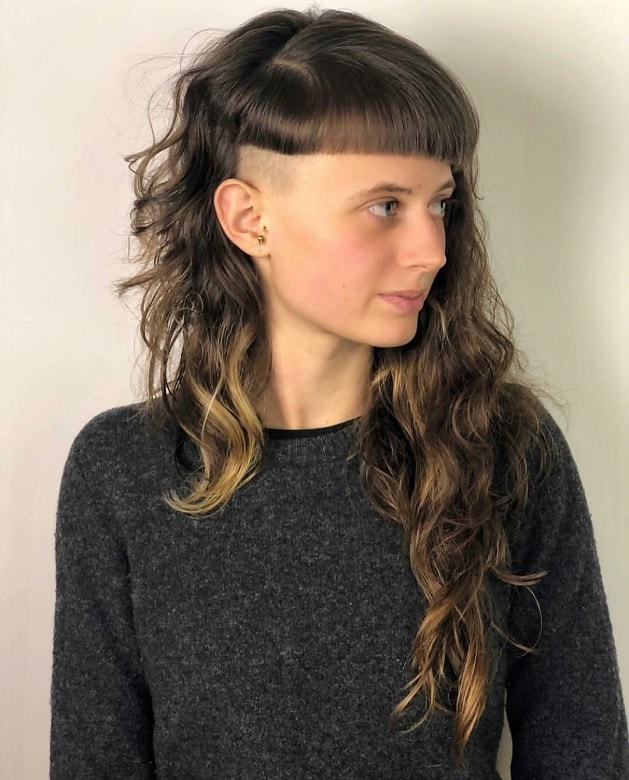 layered hairstyle with bangs for women