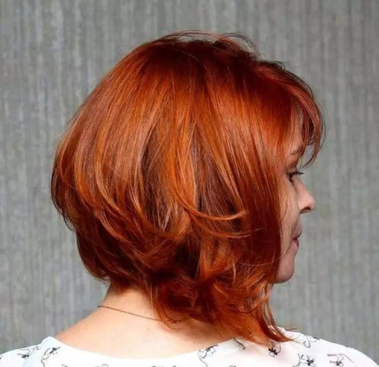 medium length layered bob with ginger red hair