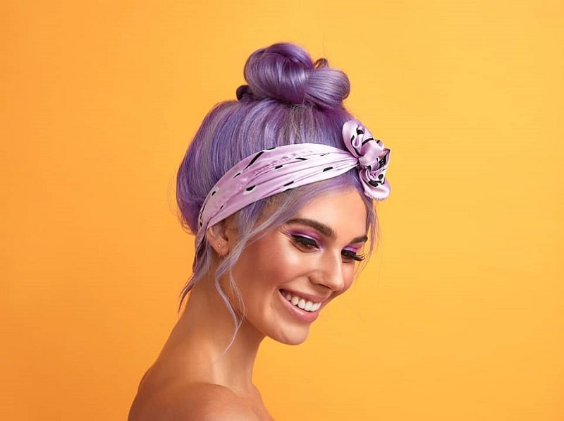 ballerina bun with pastel purple hair