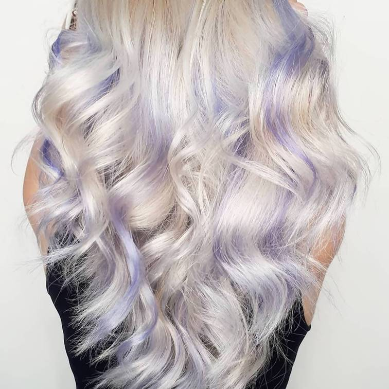 wavy ice blonde hair and purple highlights
