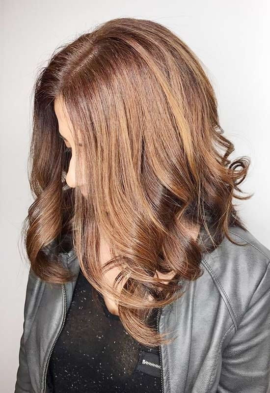 medium black hair with caramel balayage