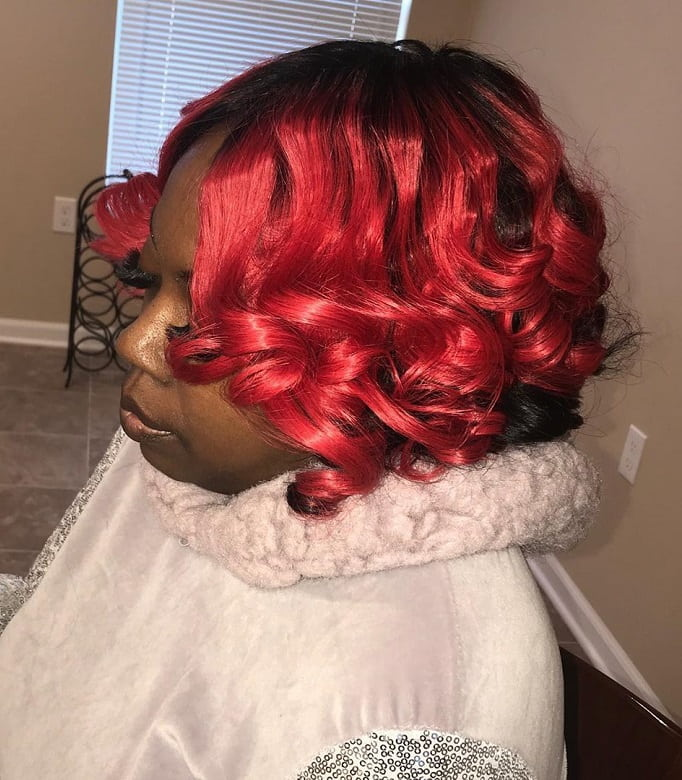 red curly sew in bob