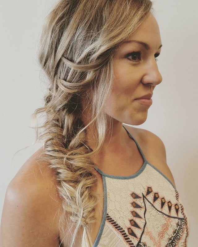 messy braid in long straight layered hair