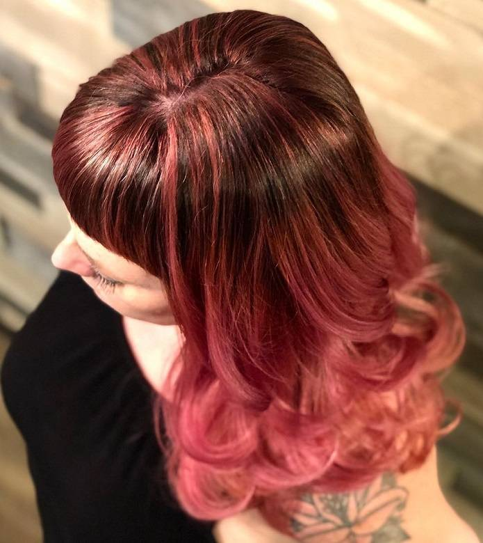 dark brown hair with pink highlights