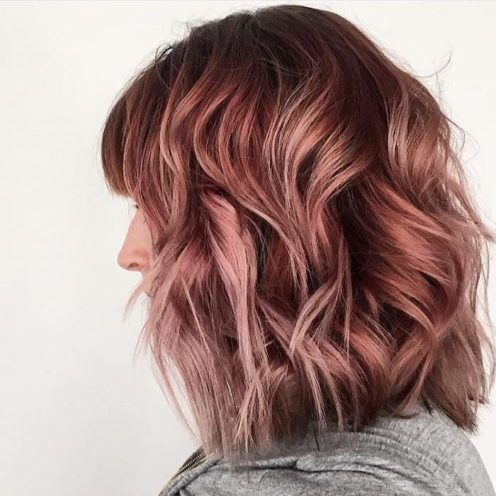 medium shaggy bob with red highlights