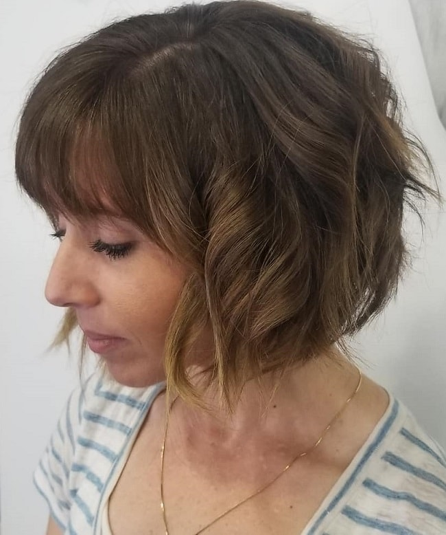 short and curly angled bob with bangs