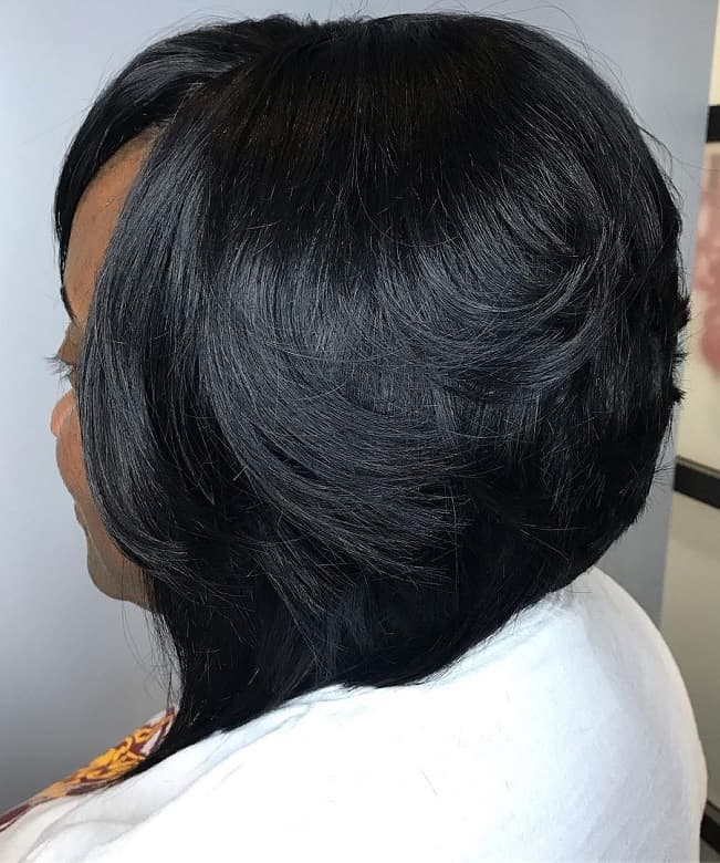 black woman with short feathered angled bob